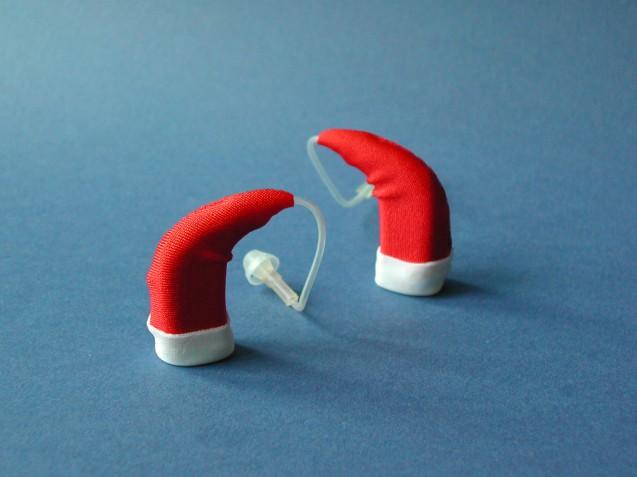 http://hearingsolutionsinc.org/wp-content/uploads/2015/12/hearing-aid-santa-hats-637x477.jpg